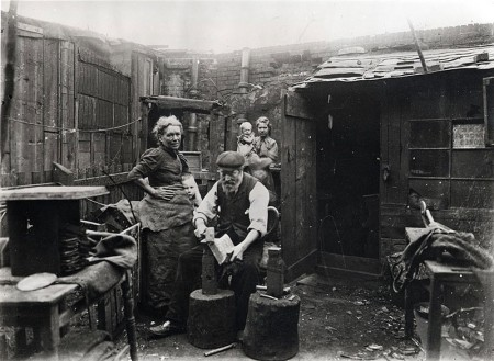 Shovel-making by a backyard blacksmith in Bethnal Green ca. 1900