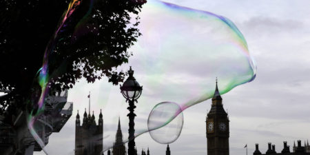 A giant soap bubble floats past the Houses of Parliament in central London October 29, 2012. REUTERS/Stefan Wermuth (BRITAIN - Tags: SOCIETY POLITICS CITYSPACE)