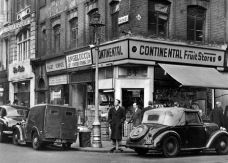 Travel, London, Businesses, pic: circa 1955, The corner of Frith Street, London, showing the continental fruit market, Italian coffee shop, Italian valet service and Italian restaurant  (Photo by Popperfoto/Getty Images)